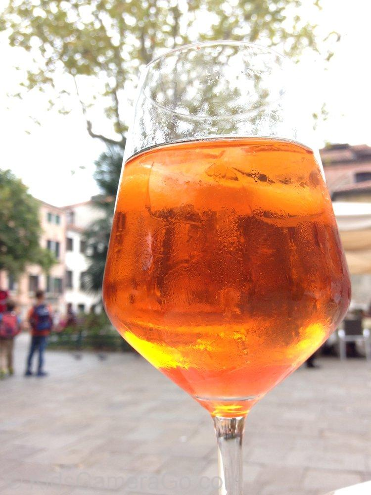 Enjoying a glass of Aperol Spritz in the best square in Venice!